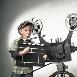 Little boy dressed as a director